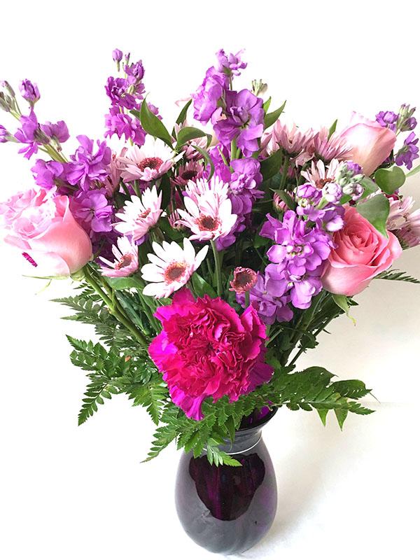 pink roses daises purple